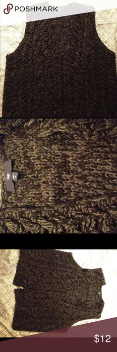 Cable knit fashion vest from the Gap. Black and grey chunky knit vest. Very gently used. An excellent layering piece! GAP Jackets & Coats Vests