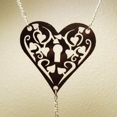 Heart Necklace with Lock and Key  'Secret Garden' Filigree Necklace- Laser Cut Acrylic. $9.50, via Etsy.