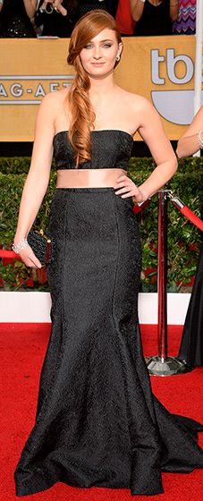 Sophie Turner: 2014 SAG Awards  Game of Thrones' Sansa all grown up! The red-headed actress wore a black bandeau bustier top and elaborate, embossed matching black skirt on the 2014 SAG Awards red carpet.  Read more: http://www.usmagazine.com/red-carpet/sophie-turner-2014-sag-awards-2014181#ixzz2qrLsoH4V
