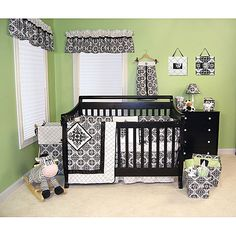 Let your little one sleep in comfort with this nonallergenic crib bedding set. This set includes a coverlet, crib skirt, diaper stacker, window valance, short and long bumpers, and crib sheet, all featuring a matching black-and-white design.