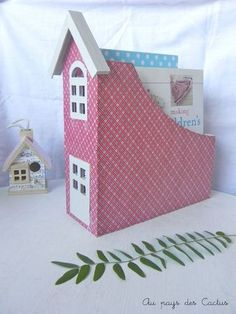 magazine rack made into a darling house. no tutorial, but fairly self explanatory. And french, need I say more??