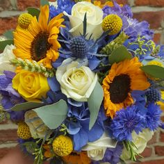 Bridal bouquet of Hydrangea, sunflowers, cornflowers, wheat, roses, craspedia, Thistles and seed eucalyptus
