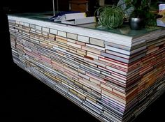 The information desk at this library is made from old, discarded books...way to recycle.
