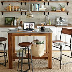 I truly like everything about this space! Rug texture, stools, wood and tile colors, fun pendant light :-)