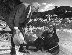 """Cecil B. DeMille - Moses speaks with God - in the person of producer-director Cecil B. DeMille - during filming of """"The Ten Commandments."""""""