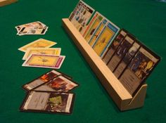 Custom made generic card holders, made from the legs of a broken desk. Rpg Board Games, Board Game Table, Wood Projects, Woodworking Projects, Dnd Table, Board Game Organization, Homemade Board Games, Game Storage, Wood Games