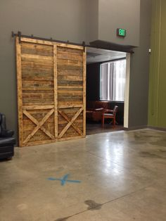 """Barn Door 104"""" high x74"""" wide created by Reconstruction Warehouse for Green Valley Church in San Diego. www.recowarehouse.com"""