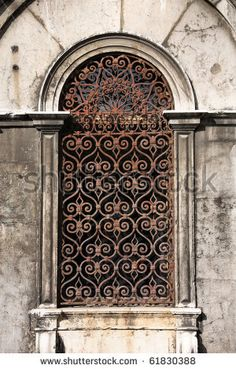 Old building in Venice, Italy. Vintage window with rusty decorative