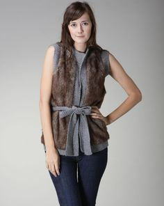 Dina says: Fur vests have been seen everywhere this season, and this one with the sweater layers and tie belt is the perfect item to keep from looking too bulky. Sweater Layering, Knit Vest, Faux Fur Vests, Taupe, Knitting, Stylish, Sweaters, Layers, Outfit Ideas
