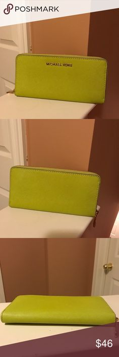 Michael Kors Jet Set Wallet Authentic lime green wallet with gold hardware in like new condition. No wear, scratches, stains, or fading.   Smoke free home.   Feel free to make me an offer.   Please see my other listings for new and gently used items from my closet. Michael Kors Bags Wallets