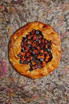 This healthy fresh and dried fruit galette combines apples and blueberries with dried apricots and dates, all baked into a guilt-free dough that is made with whole wheat and spelt flours. You can substitute other dried fruit and other berries in the filling.