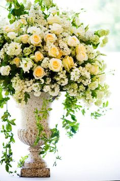 Classic urn type container for ceremony arrangements at the beginning of the aisle