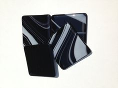 Fused glass coasters in black and white.  Set by SassyGlassBySuzy