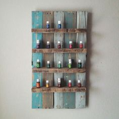 Essential oils pallet shelf with distressed shades of blue and turquoise and 2x4 shelves by House of Housley. <3