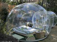 Bed in a bottle: A French hotel where the rooms are plastic bubbles (but don't worry, you can cover up at night!)