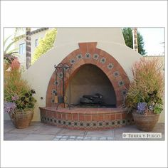 This is an example of a Spanish revival fireplace that we'll also pin within the master bedroom board. We have placed it here because the tile outline and general shape would make for such a beautiful pizza oven.
