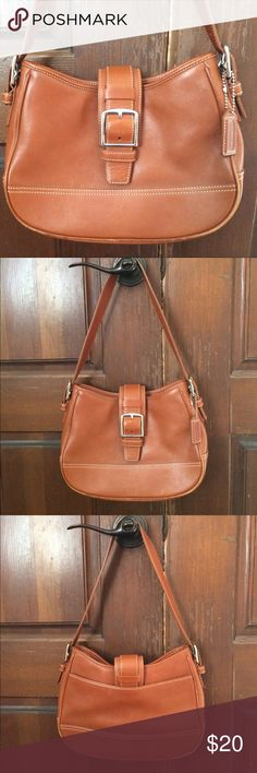 Coach Brown Leather Shoulder Bag This is a gorgeous purse! It's in excellent condition with a few minor marks on the bottom front and on the rear side of the bag. Also wear on the bottom side of the trim. (See pictures.) Otherwise, no tears and the inside is in good shape. Comes from a smoke free home. Coach Bags Shoulder Bags