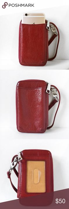 """Hobo International Red Leather Wristlet Red leather wristlet w/ yellow twill lining by Hobo International. Approx 5.5"""" x 3.5"""" x 1.25"""" (size does not include the strap). Quick access card pocket & phone pocket on exterior, gusseted zip coin pocket & 3 card slots on interior. Zips around 3 sides so it can open flat. Please note phone pocket size in photo with iPhone 6, it fits in the outer pocket but will not fit inside. Chrome exterior zipper pull & swivel strap clasp. Unmarred, no signs of…"""