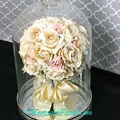 Classic rose beauty! Preserved bridal bouquet in a tabletop cloche. #floralpreservation #wedding #weddingbouquet #keepsakefloral