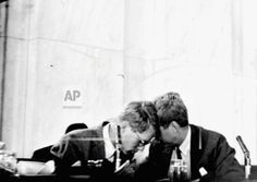 Robert Kennedy, left, counsel to the Senate Rackets Committee, confers with his brother, Sen. John Kennedy, D-MA, a committee member, during a hearing on the Teamsters Union affairs, July 8, 1959. Robert said he would remain with the committee at least through this session of Congress. There have been fresh reports that he plans to quit soon to do political work for his brother. (AP Photo/Charles Gorry)