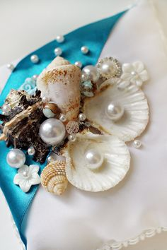 Beach wedding ring pillow Bearer ring pillow Beach wedding ring holder Seashell wedding ring holderTeal ring pillow Original ring pillows  His lovely wedding ring pillow is... #ideas #inspiration #instagram #bridal #picoftheday