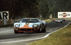 Le Mans 24H 1969 Jacky Ickx/Jackie Oliver Ford GT40 race winner car no 7 in background David Hobbs/Mike Hailwood Ford GT40