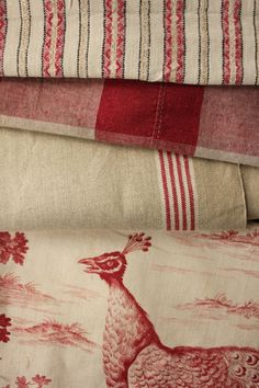 Antique fabrics: 1) striped upholstery ticking, French, c.1880. 2) Vichy checked, French,  c. 1850. 3) machine-woven flax/linen fabric with red striped sides, date unknown. 4) cotton toile, French, c. 1890.