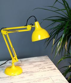 Funky metal angle poise desk lamp in zingy yellow This desk lamp has adjustable angles to help you get the right amount of light just where you need
