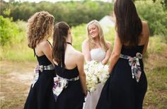 Bridesmaids with Navy dresses and plaid sashes. I kinda like this idea...