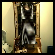 Black and white dress Black and white stripes. Material flows out a bit. Doesn't hang on you like some dresses. Cross straps on the back with elastic to help it fit well. Super cute with heels of flats. It's a perfect summer dress! ☀️ Old Navy Dresses