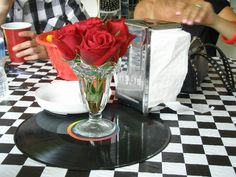 Rockabilly wedding Tablescape Centerpiece www.tablescapesbydesign.com https://www.facebook.com/pages/Tablescapes-By-Design/129811416695
