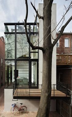 Glass house in the city.
