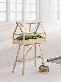 Design House Stockholm - Design House Stockholm's portable greenhouse is an at-home planter that is modeled after an indoor garden of a larger scale.