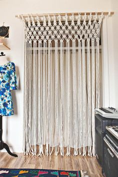 "Macramé curtain found on <a href=""http://www.abeautifulmess.com/2014/02/make-your-own-macrame-curtain.html"" target=""_blank"">A Beautiful Mess</a>"