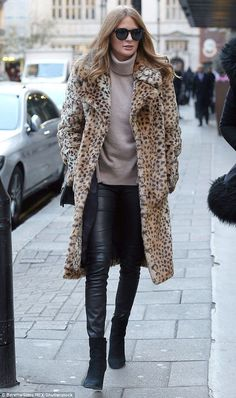Picture purr-fect: The former Made In Chelsea star, 27, was all smiles as she wrapped up warm in a statement leopard print coat and skintight leather trousers