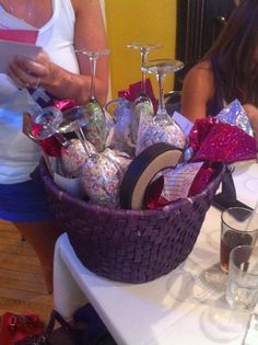 Wine basket with 5 bottles and 5 special reasons to drink each bottle...red-first fight, white-first Christmas, sparkling apple juice-first pregnancy champagne-wedding night. I threw in 4 wine glasses and 2 champagne flutes. And some other crafty ideas!