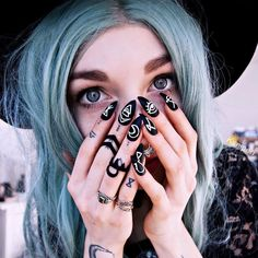 Black matte nails with Rogue & the Wolf rings