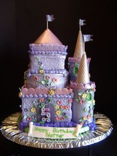 Castle Cake - This cake is for a 5 year old girl who loves princesses.  It is Chocolate cake with a layer of ganache and a layer of Twinkie filling between the layers.  It is iced in cream cheese icing with MMF details and towers.