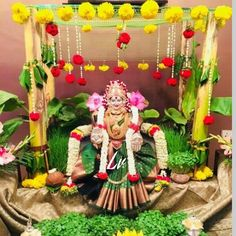 Varalakshmi Vratham 2019 honours the most popular Goddess Maha Lakshmi. Varalakshmi Puja or homam on this day means abundant wealth is sure to come your way. Background Decoration, Backdrop Decorations, Diwali Decorations, Indian Wedding Decorations, Festival Decorations, Flower Decorations, Backdrops, Mandir Decoration, Thali Decoration Ideas