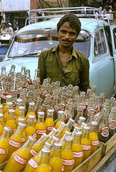 Orange Soda Vendor, India--Sell beer, my friend. That's is to much better. BELEVE ME!!!