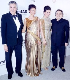 Designers Abu Jani and Sandeep Khosla are seen here, posing with models Noyonika Chatterjee and Pia Trivedi at the amfAR India gala. #Bollywood #Fashion #Style #Beauty