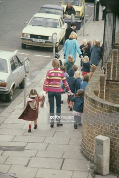 Lady Diana Spencer holding hands with some of her pupils of the Young England kindergarten, Pimlico, London, January Get premium, high resolution news photos at Getty Images Princess Diana Hair, Princess Diana And Charles, Princess Diana Fashion, Princess Diana Pictures, Queen Pictures, Princess Of Wales, Spencer Family, Lady Diana Spencer, Diana Williams