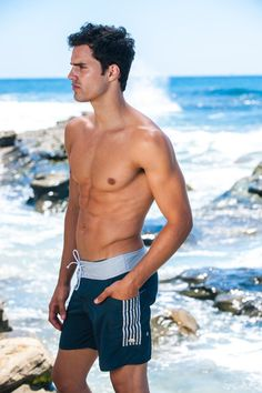 Sauvage Swimwear - Designer Board Shorts - Get ready for a classic kind of comfort and style with this fun and sporty Sauvage Swimwear Slate Pocket Board Short. Offered in a warm navy with rich grey stripes and waistband, this style is the perfect one for those who want a modern cut and style with traditional, well-loved colors. #designerboardshorts