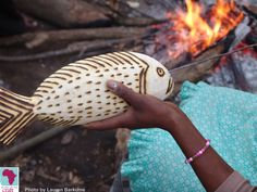 A member of the family business Nonhlo Pheko in Port St. Johns creates a carved wooden fish. The Africa Craft Trust worked from 2007-2010 on a Kellogg Foundation funded programme working with small craft businesses in the wild coast of the Eastern Cape, South Africa.