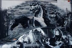 Banksy's NYC Latest: Crazy Horses Riding Through The Lower East Side to a WikiLeaks Soundtrack