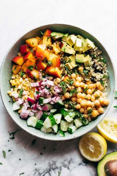 Couscous Summer Salad! Spiced couscous, juicy nectarines, crunch cucumber, avocado, chickepeas, cherries, sweet corn, and mint. It's sunshine in a bowl! #salad #summer #vegetarian #vegan #recipe #healthy | pinchofyum.com