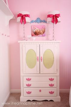 I love how they painted the ugly gold drawer pulls pink.  It looks really nice
