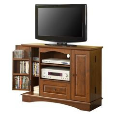 "42"" Bedroom TV Console w/ Media Storage - Traditional Brown. Dimensions: 42 W x 16 D x 32 H. Ships ready-to-assemble with necessary hardware and tools. Stylish, traditional design. High-grade MDF and durable laminate construction. Rich, natural wood color. Accommodates most flat-panel TVs up to 50 in. Weight capacity of 250 lbs. Single drawer. Door storage holds approximately 150 DVDs/Blu-ray discs. Assembly instructions included with toll-free number and online support."