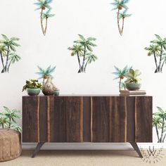 Large palm tree wall decor as a pattern on a white wall behind a dark wooden table. There are two different palm tree patterns interspersed, one type of palm tree with a two leaves, the other with three. Tree Wallpaper Bedroom, Of Wallpaper, Kids Room Wall Decals, Vinyl Wall Stickers, Wall Murals, Wall Patterns, Tree Patterns, Tree Decals, Tree Wall Decor
