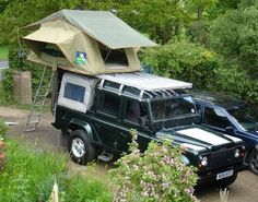 Land Rover Defender 110 Td5 Double Cab pickup for camping. Nice Epson Green color.